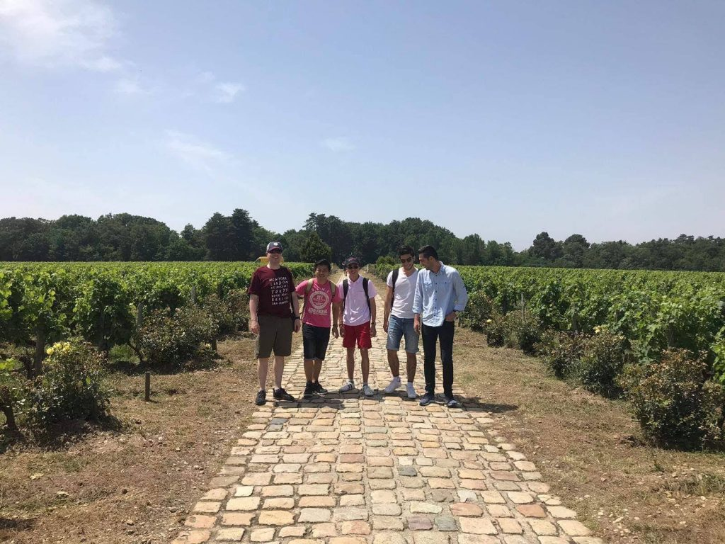five people standing in front of a winyard